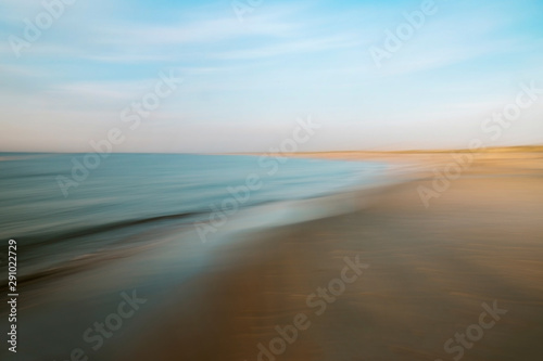 Spoed Fotobehang Water Scenic View of Ocean Shoreline at Sunset