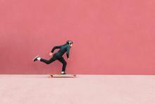 Full Length Of Man Skateboardi...