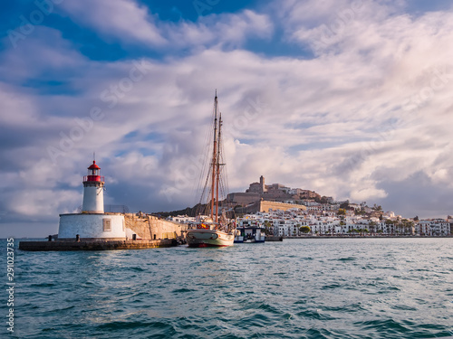 Cadres-photo bureau Ville sur l eau Lighthouse, bay and ancient city of Ibiza over Mediterranean sea