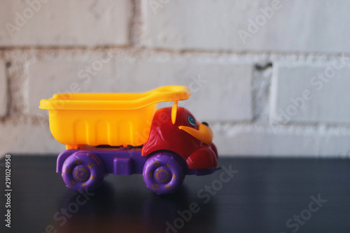 Toy truck on a black table.