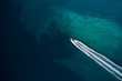 Aerial view of speed motor boat in shallow water