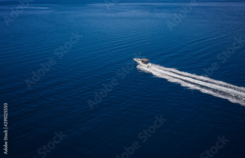 Aerial view of speed motor boat on open sea