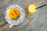 Pumpkin cream soup and orange fresh