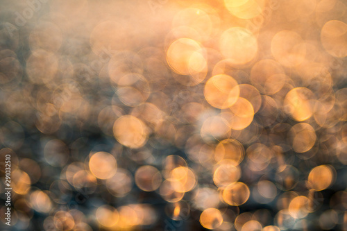 Bokeh of bright lights on rocky beach