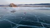woman skating on the frozen baikal lake