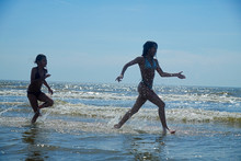 Two Young Girls Having Fun Run...