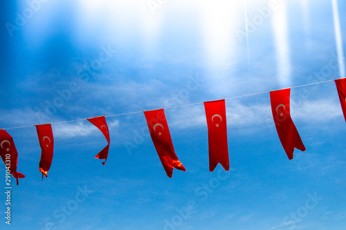 Stampa su Tela  Turkish national flags with white star and moon in sky