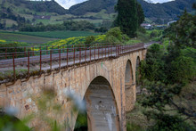 View Of The Old Bertucci Train Bridge Built In 1931 At The Highlands Of The Andean Mountains Of Central Colombia.