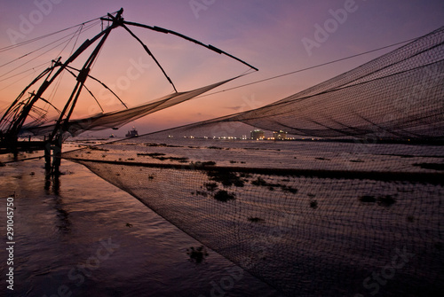 Poster Salmon Twilight in the Chinese Fishing Nets of Fort Kochi