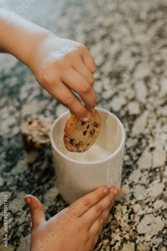 child's hands Milk and cookies