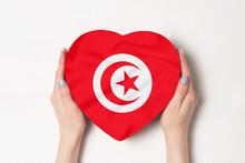 Flag Of Tunisia On A Heart Shaped Box In A Female Hands. White Background