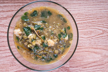 Mung Beans With Shrimp And Malunggay Leaves Stew, Topped With Fried Pork Skin