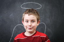 Funny Boy With Angel Halo And Wings Drawn In Chalk