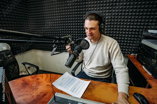 Fotografie, Tablou Talking male radio presenter in radio station