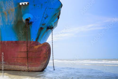 Industrial sea vessel shipwreck on coastline after storm accident Wallpaper Mural