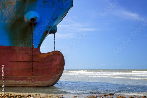 Industrial sea vessel shipwreck on coastline after storm accident Canvas Print