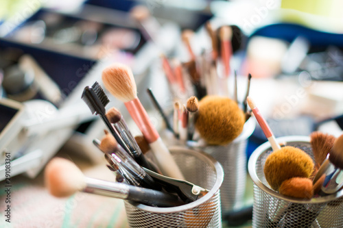 Fototapeta Close up of a set of make up brushes against a bokeh background obraz na płótnie