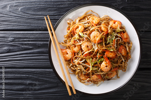 Authentic chow mein noodle fried with shrimp, vegetables and sesame seeds close-up on a plate Wallpaper Mural