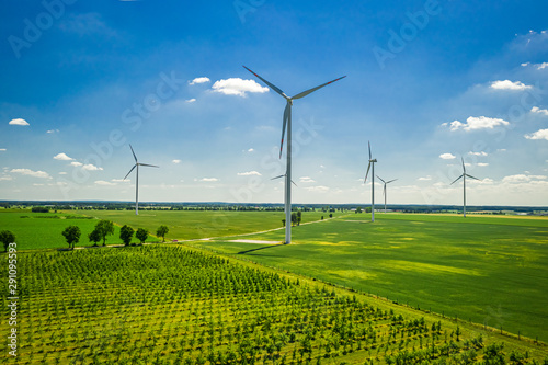Fotografia  Big wind turbine on field in sunny Poland, aerial view