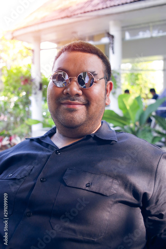 Fat People Wearing Black Clothes Are Smiling Happy Fat People With Glasses Buy This Stock Photo And Explore Similar Images At Adobe Stock Adobe Stock