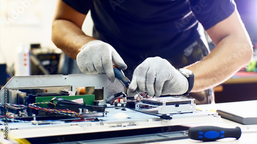 Fototapeta Professional technician detaches monoblock hard drive repairing it in workshop. obraz