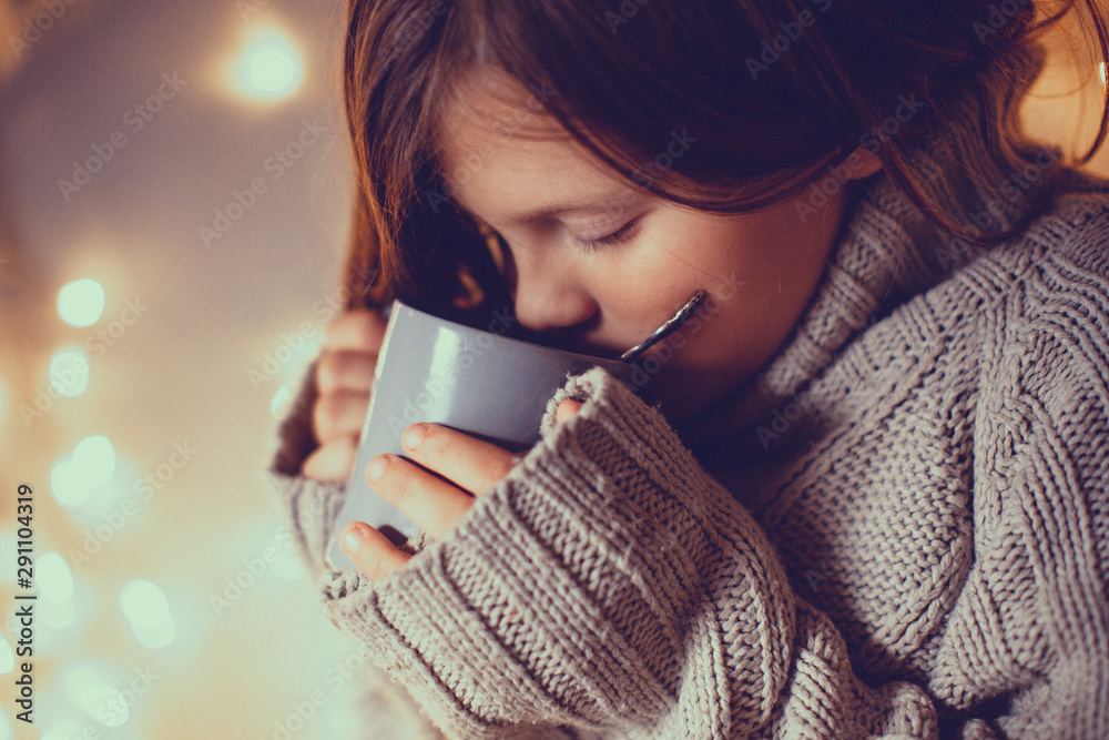 Fototapeta girl child in sweater with cup, cozy , toning
