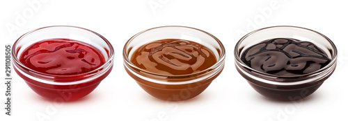 Caramel, chocolate sauces and red berry jam isolated on white background - 291108505