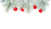 Green Fir Branch And Red Glass Baubles Isolated On White Background. Christmas Decorations Border