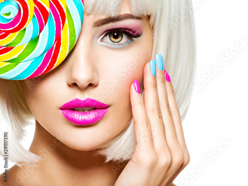 face-of-a-beautiful-girl-with-pink-eye-make-up-and-multicolor-nails-sweet-candy