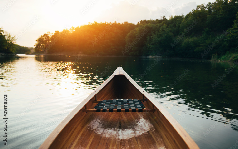 Fototapeta Canoe bow seat and deck on the sunset lake