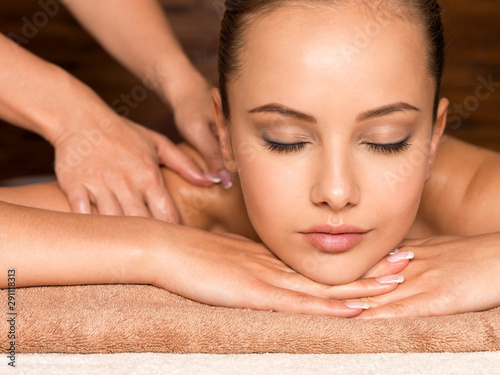 Canvastavla Beautiful young woman relaxing in the spa salon.