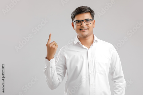 Valokuvatapetti Young Indian voter showing finger