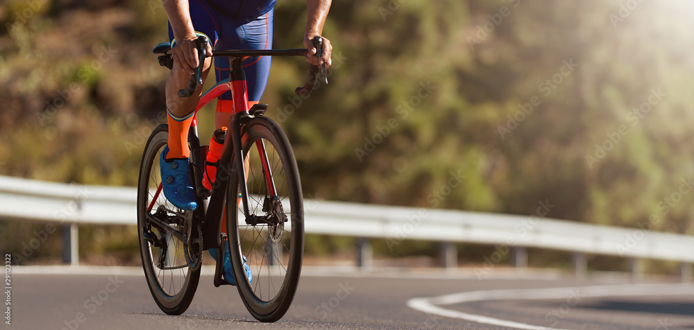 Fototapeta Road bike cyclist man cycling, are cycling road bike in the morning,  detail of cycling shoes