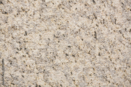 Photo sur Toile Marbre Punctual granite texture in ideal light tone.