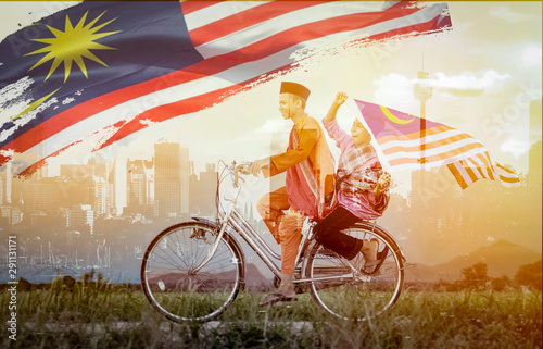 Fotomural  independence Day concept - Two happy young local boy riding old bicycle at paddy
