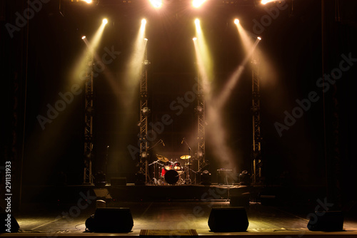 Lights beams on stage with musical instruments - 291131933
