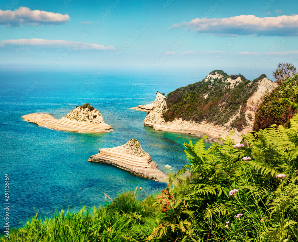 Great view of Cape Drastis thematic park. Fantastic morning seascape of Ionian sea. Nice outdoor scene of Corfu island, Greece, Europe. Beauty of nature concept background.