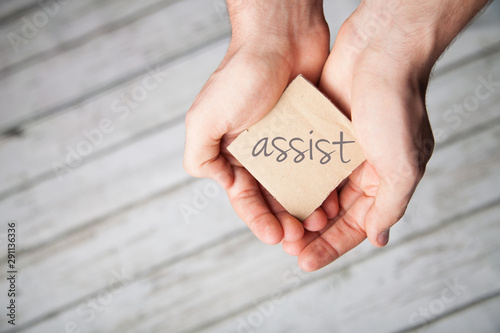 Assist, or assitance in two hands Canvas Print