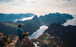 canvas print picture -  Tourist man hiker on top of the mountain. Active life concept