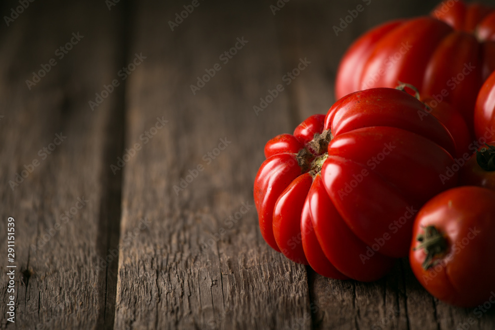 Fototapety, obrazy: Fresh, ripe tomatoes on wood background.