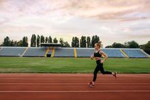 Female Runner Jogging, Training On Stadium