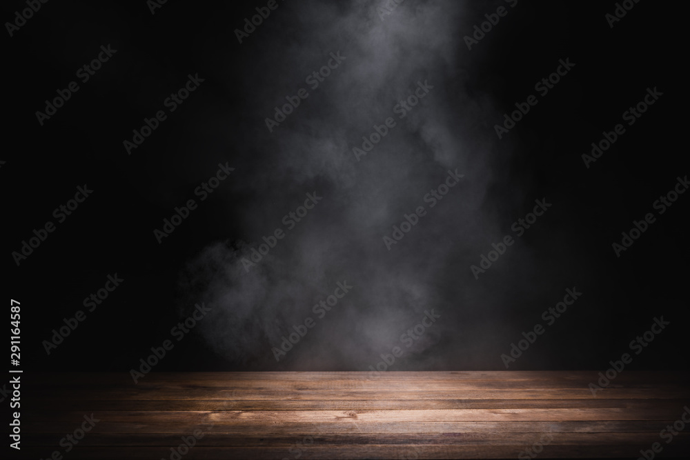 Fototapeta empty wooden table with smoke float up on dark background