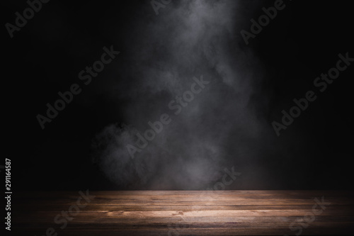 Poster de jardin Fumee empty wooden table with smoke float up on dark background