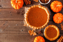 Homemade Autumn Pumpkin Pie Corner Border. Top View Table Scene Over A Rustic Wood Background With Copy Space.