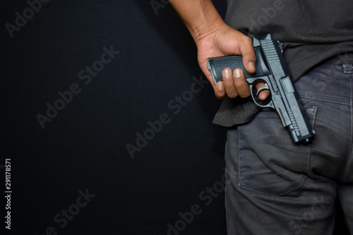 asian man holds a gun Wallpaper Mural