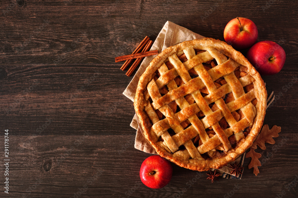 Fototapety, obrazy: Homemade autumn apple pie, top view with frame of ingredients on a dark wood table with copy space