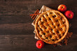 canvas print picture - Homemade autumn apple pie, top view with frame of ingredients on a dark wood table with copy space
