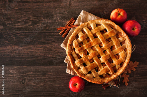 Fotografie, Obraz  Homemade autumn apple pie, top view with frame of ingredients on a dark wood tab