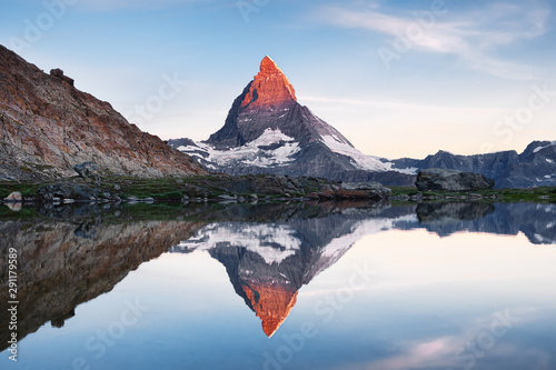 Matterhorn and reflection on the water surface during sunrise Wallpaper Mural