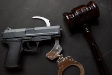 Gun, Handcuffs And Black Gavel...